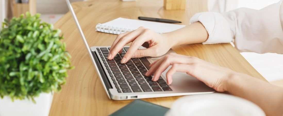 woman typing in the keyboard