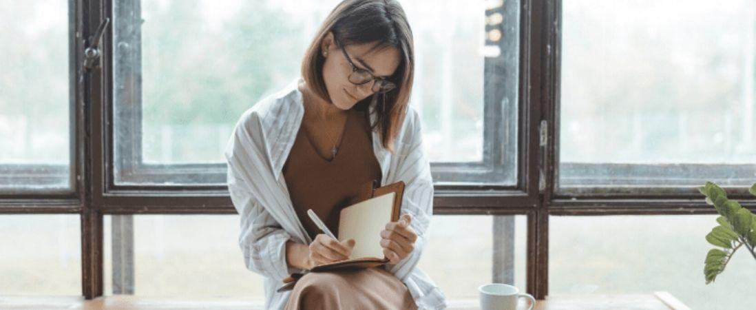 woman writing personal blog