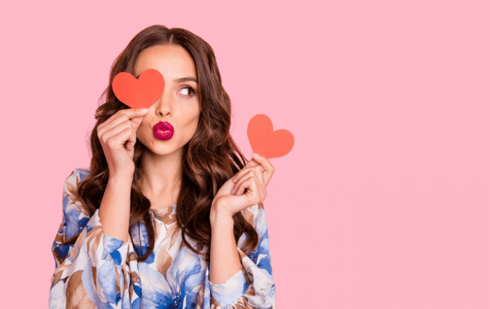 pretty lady sending hearts to get people love image and brand