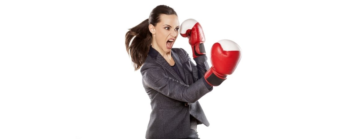 woman in leadership ready to fight wearing gloves